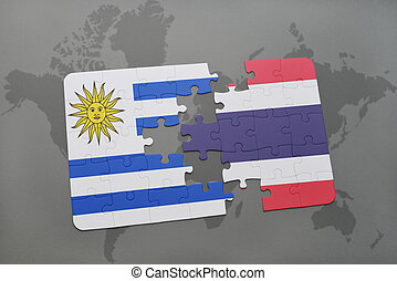 puzzle with the national flag of uruguay and thailand on a world map