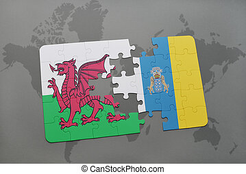 puzzle with the national flag of wales and canary islands on a world map background.