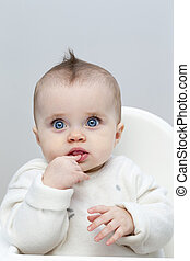 Puzzled Baby in Highchair