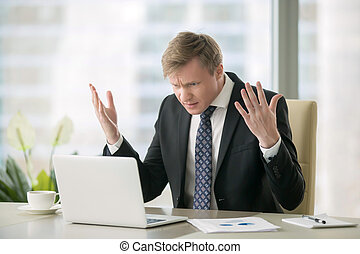 Puzzled businessman in office