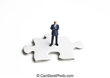 Puzzled by business - Businessman figurines placed with...
