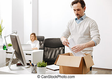 Puzzled employee gathering the box and leaving the company -...