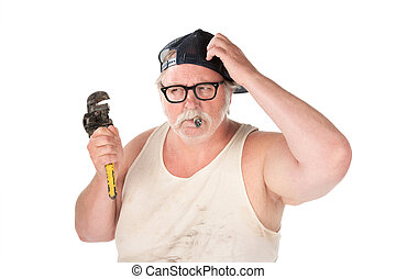 Puzzled plumber with pipe wrench and cigar