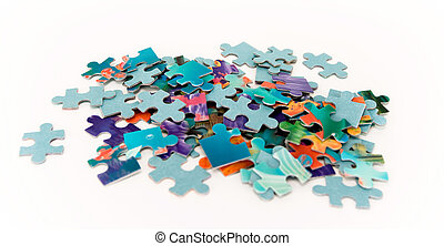 Scattered colored puzzles on a white background