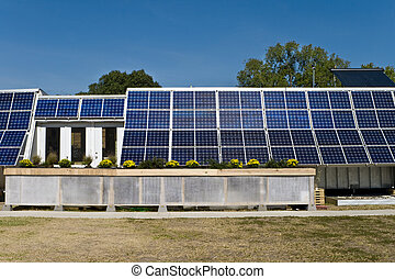 PV Solar Panel Array Mounted on Home Blue Sky - Solar...