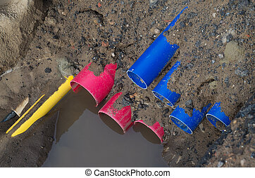 pvc pipes in a ditch - ditch with colorful pvc pipes on a...