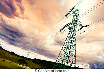 High-voltage tower backlit with idyllic sky
