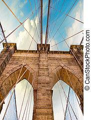 Pylon of Brooklyn Bridge. Magnificent structure at dusk -...