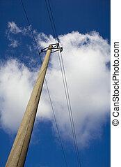 pylon against cloudy sky