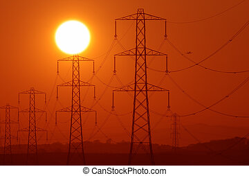 pylon sunshine - Sun above a row of electricity pylons