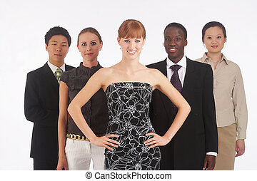 a group of young, international businesspeople standing in one row, the red haired girl in the front as the boss