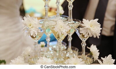 Pyramid champagne martini glasses at weddng
