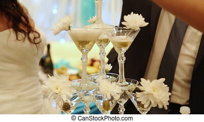 Pyramid champagne martini glasses at weddng