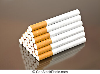 Pyramid from cigarettes - 21 cigarettes as a pyramid on a...