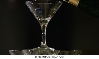 Pyramid from glasses of champagne on wedding party