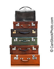 Pyramid from old suitcases - Old suitcases isolated on a ...