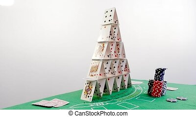 Pyramid House of Cards Falling Down in Slow Motion