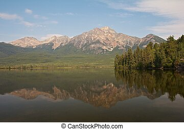 Pyramid Lake with Pyramid Island and a mountain reflecting in the quiet waters