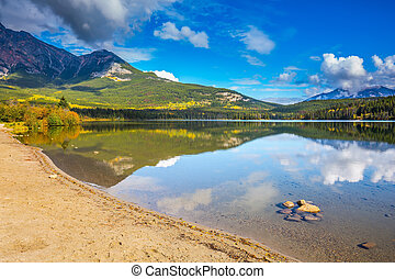 Pyramid Mountain is reflected in Pyramid Lake - Cold autumn ...
