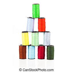 Pyramid of colourful cotton yarns