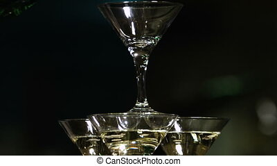 Pyramid of glasses of champagne. Drinks at the party. Golden colors.