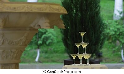 Pyramid of glasses of champagne. Drinks at the party.