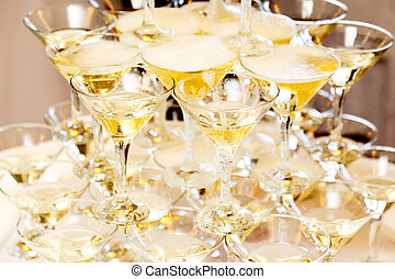 Pyramid of glasses with champagne close up
