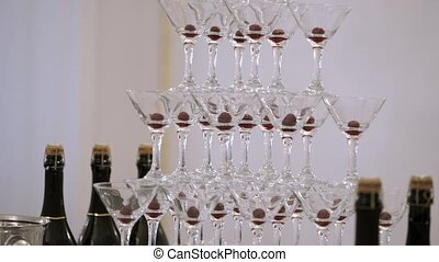 Pyramid of glasses with champagne at the party