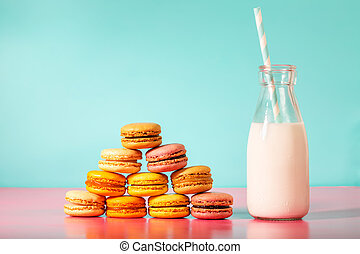Pyramid of macarons with milk in a bottle