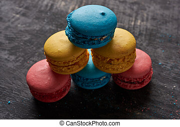 Pyramid of multicolored macaroon on a table close-up