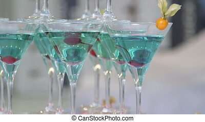 Pyramid of red blue champagne