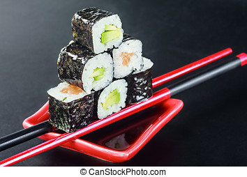Pyramid of rolls on sticks for sush