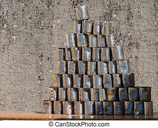 Pyramid of stacked aluminum cans