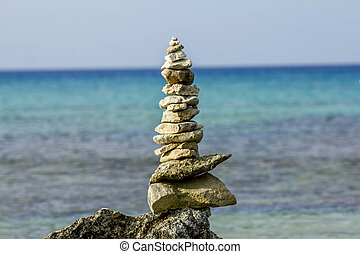Pyramid of stones on a background of beautiful sea landscape