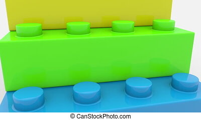 Pyramid of toy bricks in various colors on white