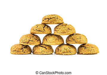 Pyramid of traditional pepernoten treats on white background