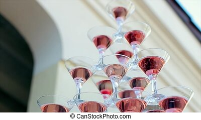 Pyramid of Wineglasses with Pouring Champagne - pyramid of...