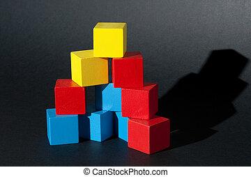 Pyramid of Wooden blocks - Wooden blocks form a pyramid.