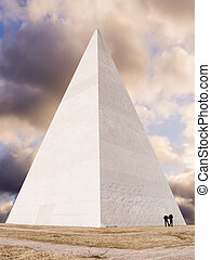 Pyramid on a background of the sky with silhouettes of...