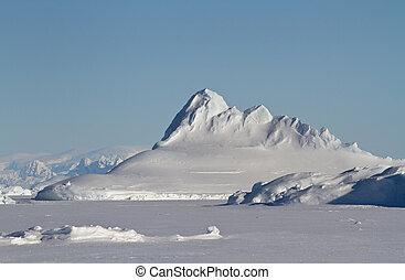 Pyramid prominent iceberg frozen in winter Antarctic waters