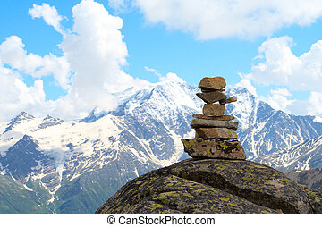 pyramid of stones and mountains with blue cloudy sky in the...