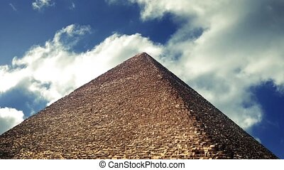 Pyramid With Clouds Moving Past - Large pyramid on a sunny...