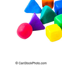 Pyramids, cubes and balls made with colorful plasticine,  on the white background