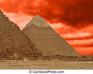 Pyramids of Gizeh near Cairo in Egypt and red clouds