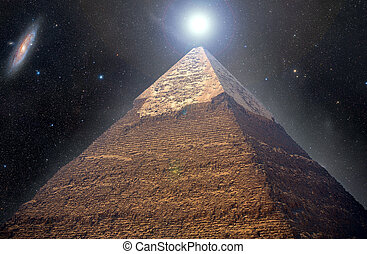 Pyramids of Giza in the background of the starry night sky. Elements of this image furnished by NASA
