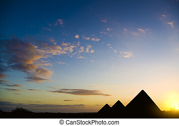Pyramids in Giza valley under sunset light