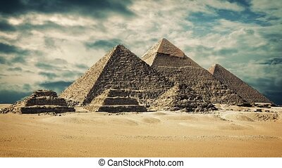 The Giza pyramid complex with dramatic timelapse sky