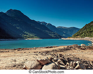 Pyrenees mountains and lake landscape.