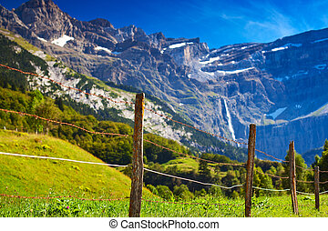 Pyrenees mountains and fence for animals.