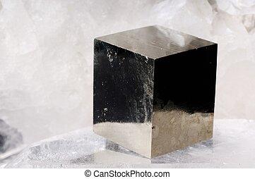 Pyrite cube crystal on quartz background